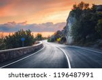 mountain road at sunset.... | Shutterstock . vector #1196487991