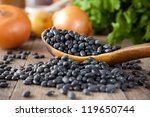 black beans in a wooden spoon... | Shutterstock . vector #119650744