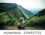 woman traveler holding hat and... | Shutterstock . vector #1196517721