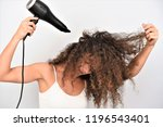 pretty young woman blowing her... | Shutterstock . vector #1196543401