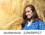 side portrait of smiling young...   Shutterstock . vector #1196589517