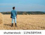 man farmer agronomist in jeans...   Shutterstock . vector #1196589544
