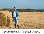 young farmer in jeans  white t...   Shutterstock . vector #1196589547