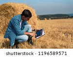 young male farmer agronomist...   Shutterstock . vector #1196589571