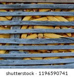 corn in the wooden barn. | Shutterstock . vector #1196590741