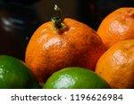 tangerine and lemon on a table. | Shutterstock . vector #1196626984