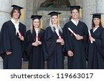 smiling graduates posing in...   Shutterstock . vector #119663017