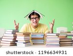 student with too many books to... | Shutterstock . vector #1196634931