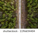 road through the taiga forest.... | Shutterstock . vector #1196654404
