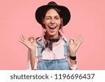 beautiful cheerful woman blinks ...   Shutterstock . vector #1196696437