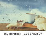 coffee cup on a rainy day over... | Shutterstock . vector #1196703607