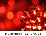 Christmas lights on red background with copy space - stock photo