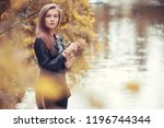 young girl in autumn in rainy... | Shutterstock . vector #1196744344