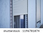 window with half closed roller... | Shutterstock . vector #1196781874