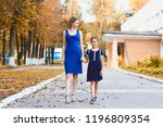 young mother picks up little... | Shutterstock . vector #1196809354