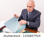 business man with your files... | Shutterstock . vector #1196857924