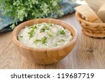 Mashed potatoes and cabbage in a wooden bowl on the table - stock photo