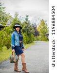 fashionable nice woman walking... | Shutterstock . vector #1196884504