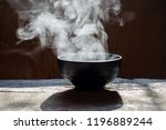 steam of hot soup with smoke in ... | Shutterstock . vector #1196889244
