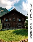 Steg, Liechtenstein, 20th August 2018:- A traditional alpine wooden chalet in the central Liechtenstein village of Steg - stock photo
