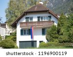 Vaduz, Liechtenstein, 16th August 2018:- A house in Vaduz, capital of Liechtenstein flying the national flag - stock photo