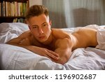 shirtless sexy male model lying ... | Shutterstock . vector #1196902687