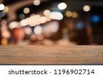 empty dark wooden table in... | Shutterstock . vector #1196902714