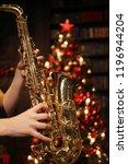 woman plays saxophone in studio ... | Shutterstock . vector #1196944204