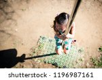 girl playing with climbing... | Shutterstock . vector #1196987161