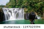 digital camera over tripod on... | Shutterstock . vector #1197025594