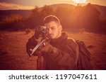 hunter with powerful rifle with ... | Shutterstock . vector #1197047611