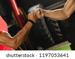 respect in sport. two muscular... | Shutterstock . vector #1197053641