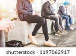 friends group sitting and using ... | Shutterstock . vector #1197062917