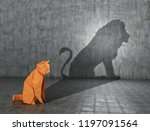 Stock photo concept of hidden potential a paper figure of a cat that fills the shadow of a lion d 1197091564