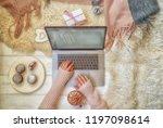 woman's hands typing on laptop... | Shutterstock . vector #1197098614