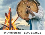 shaman plays drums near the big ... | Shutterstock . vector #1197122521