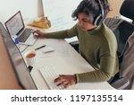 female programmer coding on a... | Shutterstock . vector #1197135514