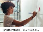portrait of young woman writing ... | Shutterstock . vector #1197135517
