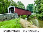 amish covered bridge buggy...   Shutterstock . vector #1197207817