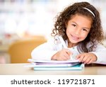 cute little girl studying at... | Shutterstock . vector #119721871