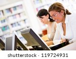 female students researching at... | Shutterstock . vector #119724931