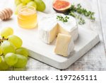 cheese plate with brie ... | Shutterstock . vector #1197265111