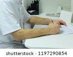 writing doctor's hands | Shutterstock . vector #1197290854