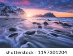 sandy beach with stones in... | Shutterstock . vector #1197301204