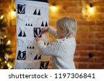 happy little boy takes sweet...   Shutterstock . vector #1197306841