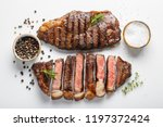 two grilled marbled beef steaks ... | Shutterstock . vector #1197372424