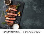 sliced steak striploin  grilled ... | Shutterstock . vector #1197372427