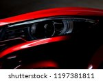 closeup headlight of shiny red... | Shutterstock . vector #1197381811
