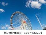 ferris wheel on a fairground in ...   Shutterstock . vector #1197433201