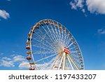 ferris wheel on a fairground in ...   Shutterstock . vector #1197433207